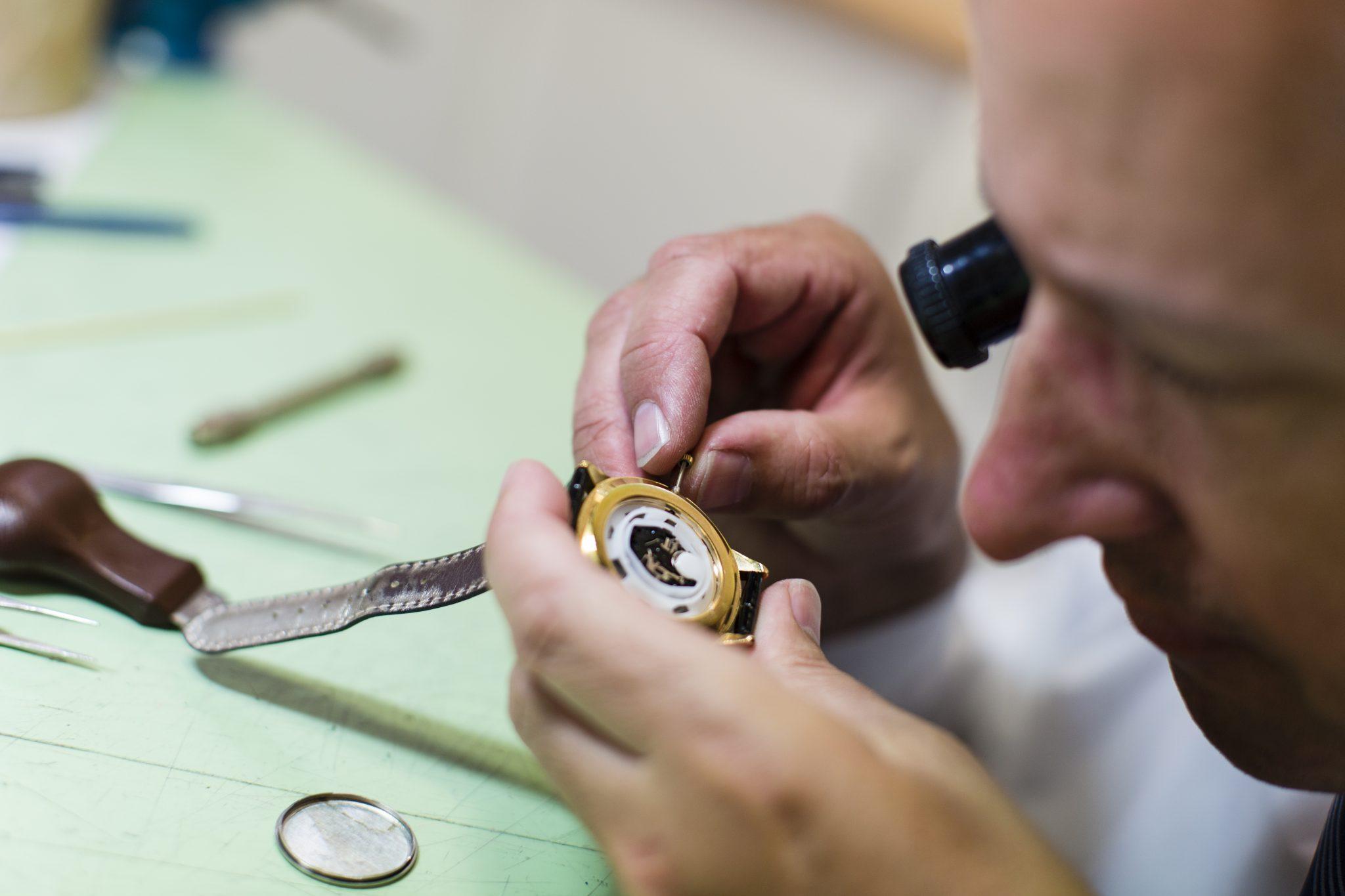 man repairing watch